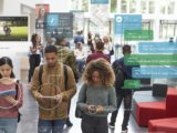People using social media apps on street showing the analysis on data privacy violations since Cambridge Analytica scandal