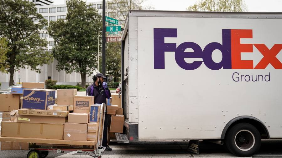 Coronavirus: FedEx results top view boosted by home deliveries — as it happened