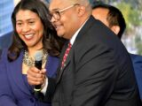 San Francisco Mayor London Breed, left, joins then-Transbay Joint Powers Authority Board Chair Mohammed Nuru in turning on a bus schedule screen to celebrate the opening of the new Salesforce Transit Center in downtown San Francisco on Aug. 10, 2018. Nuru was arrested by the FBI in 2020 on corruption charges.